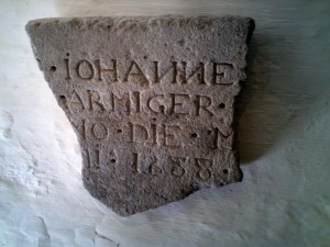 Broken memorial stone dated 1588 comemorating James Bradshaw of the Abbey.