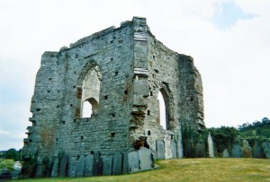 The North Transept of ca.1500 survives to almost full height with a large arched-headed window to each outer wall, and large external corner buttresses
